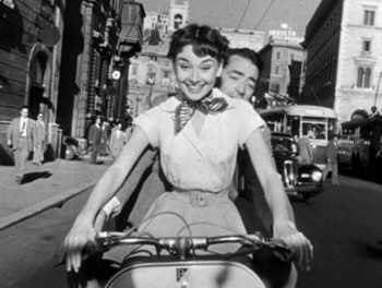 Audrey_Hepburn_and_Gregory_Peck_on_Vespa_in_Roman_Holiday_trailer-thumb[1].jpg